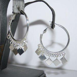 Silver hoop earrings with charms
